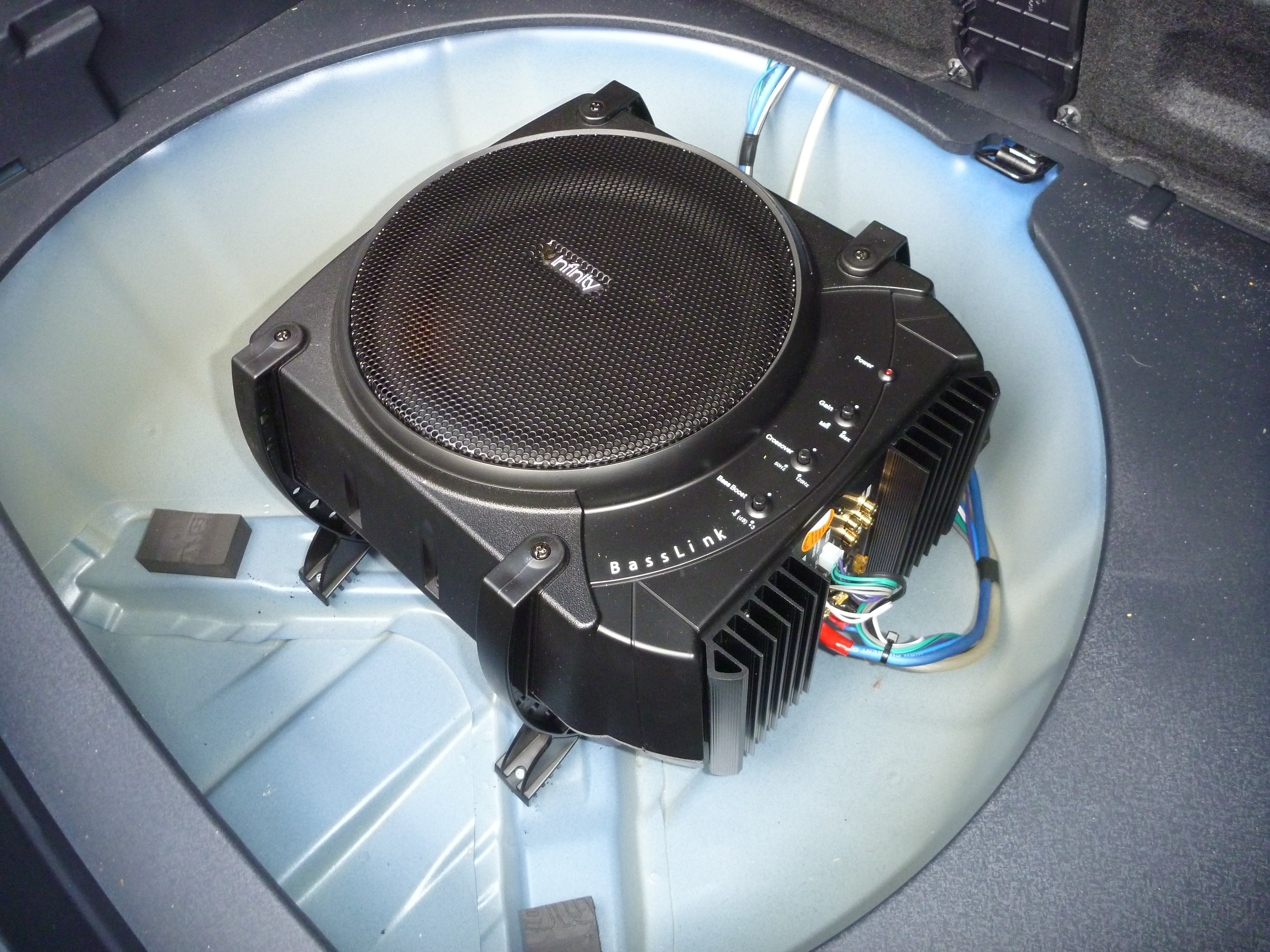 2013 Kia Rio Infinity Basslink powered subwoofer in spare tire well.